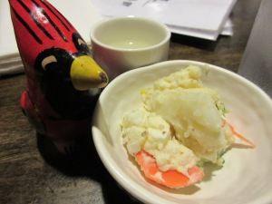 Start things off with a little Japanese potato salad and warm sake